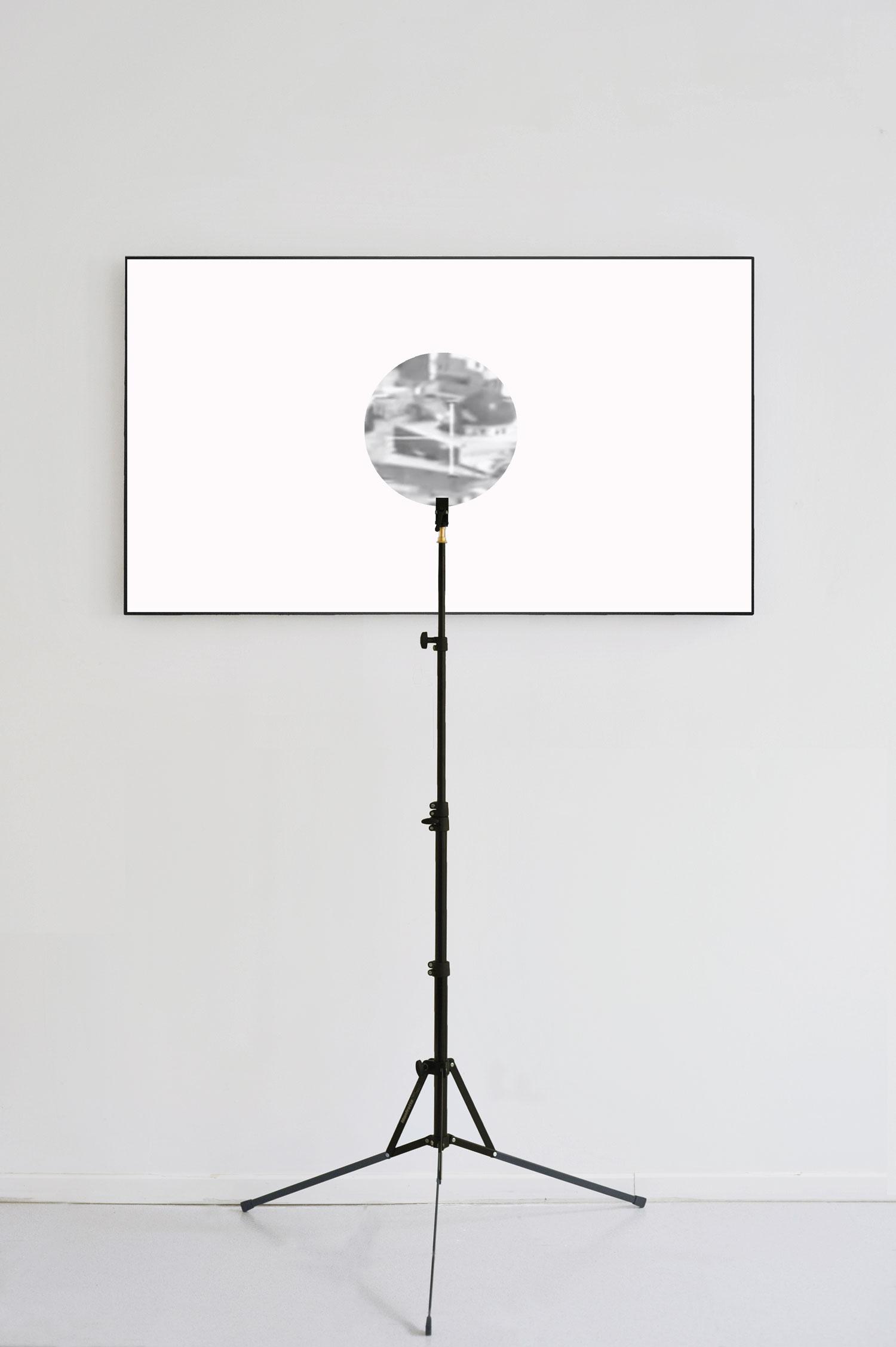1---Emmanuel-Van-der-Auwera,-VideoSculpture-XXII-(White-Noise),-2020,-55-inch-LCD-screen,-polarization-filter,-plexiglass,-tripod,-cables,-HD-video,-38-min-13-sec,-height-190-cm-height-74-3_4-in,-Ed-3+2-AP